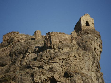 stephen-alvarez-a-ruined-fortress-stands-upon-a-rocky-hill